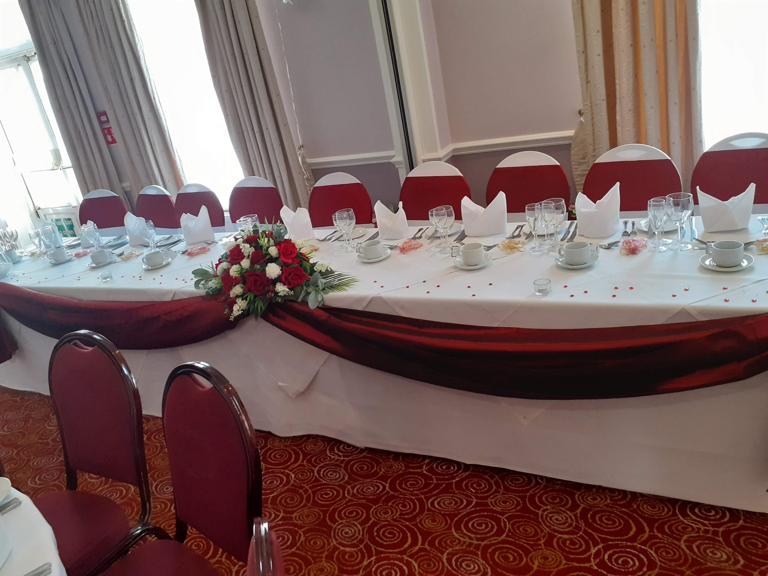 Red Satin Themed wedding with Red rose long and Low