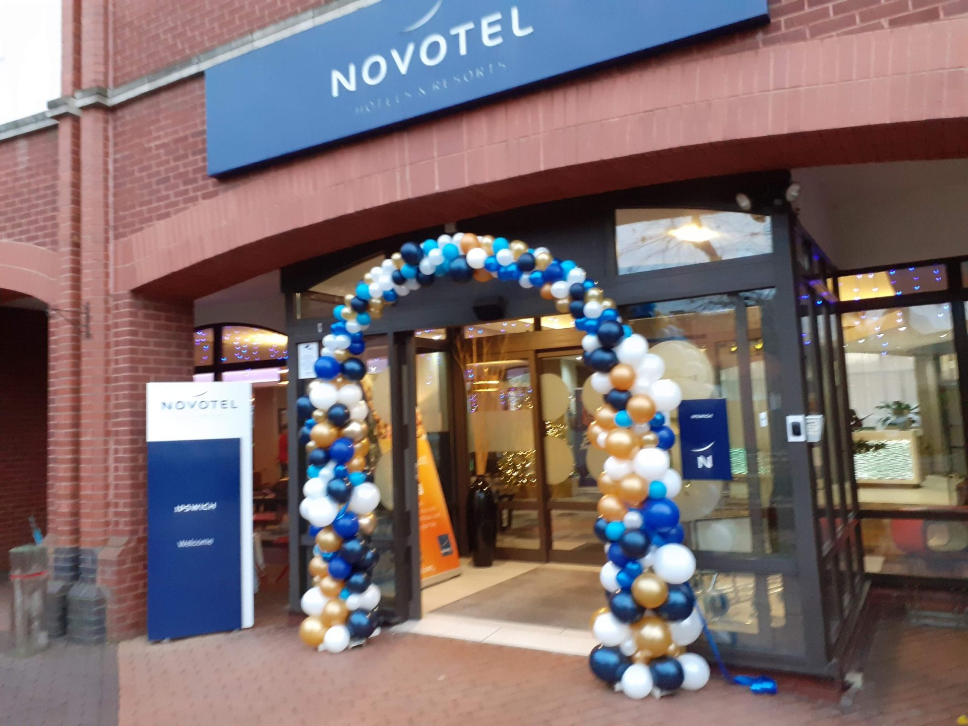 Blue, Gold and White themed Balloon arch