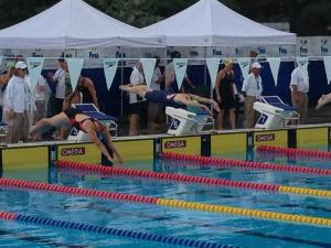 Picture of Kirsten Patrick competing in a relay event (centre)
