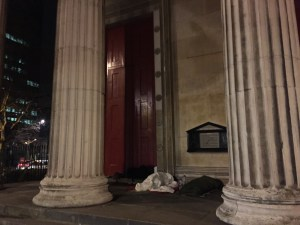 Picture of homeless people sleeping on the portico of St Pancras Church, Euston, London UK
