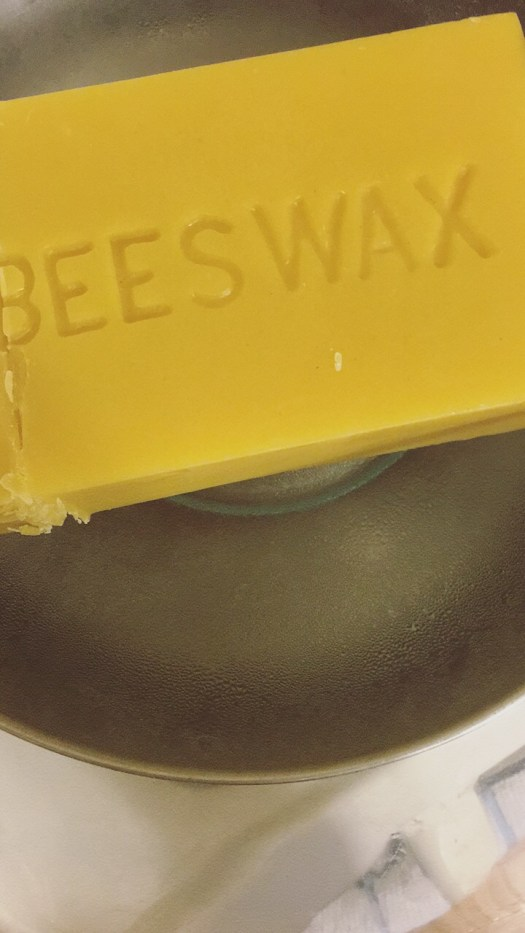 Melt beeswax in a double boiler