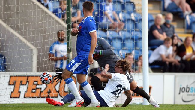Dele Alli chests home Tottenham's third goal during the 3-0 friendly win at League Two Colchester
