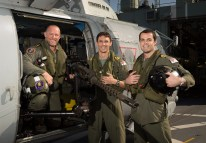 From left Leading Seaman Aircrew Karl Beyer, Lieutenant (LEUT) Caleb Muggeridge and LEUT Gregory Payne with HMAS Arunta's Helicopter (Predator) while on patrol in the Middle East Region. *** Local Caption *** HMAS Arunta operates as part of the multi-national Combined Maritime Forces, predominately tasked to support Combined Task Force 150 for counter-terrorism and maritime security operations. Arunta is deployed on Operation MANITOU, supporting international efforts to promote maritime security, stability and prosperity in the Middle East region (MER). Arunta is on her third deployment to the MER and is the 64th rotation of a Royal Australian Navy vessel to the region since 1990