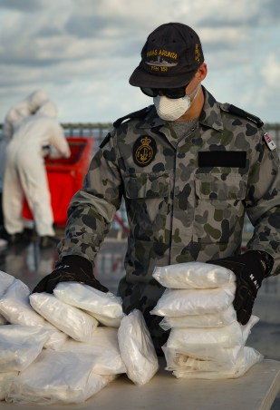 An HMAS Arunta sailor prepares illegal narcotics for weighing and destruction after the ship's seizure of 260kg of drugs during their operation Manitou patrol in the Middle East region on 8 June 2017. *** Local Caption *** HMAS Arunta operates as part of the multi-national Combined Maritime Forces, predominately tasked to support Combined Task Force 150 for counter-terrorism and maritime security operations. Arunta is deployed on Operation MANITOU, supporting international efforts to promote maritime security, stability and prosperity in the Middle East region (MER). Arunta is on her third deployment to the MER and is the 64th rotation of a Royal Australian Navy vessel to the region since 1990.