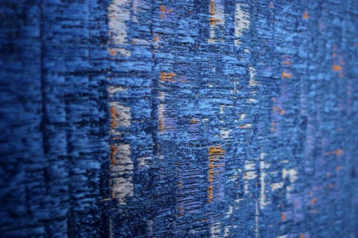 Thermochromic, color-changing tapestry