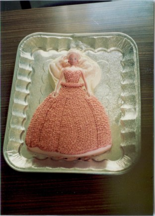 Barbie - The upper portion of her body is a plastic piece that came with the cake pan, you just need to cover it with stars so it'll blend in with the rest of the cake.