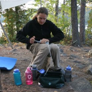 Using a water filter while canoe camping