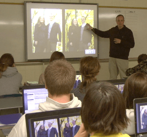 Paul teaching photo editing to students.