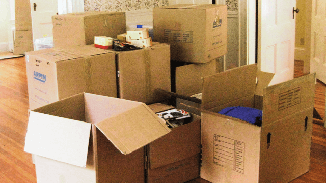 Medium and large boxes in the process of being tightly packaged and organized
