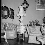 Interior Of Living Room Or Furniture Store With Diamond Shaped Mirrored Wall Clock And Two Sofas Or Love Seats Cmoa Collection