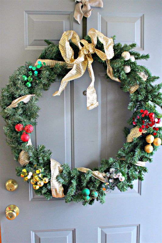 It isn't terribly hard or expensive to decorate a hand me down Christmas wreath and spruce up your front door!