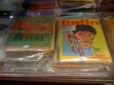 Ensemble d'environ 65 numéros de bande dessinée, revues, magazines comportant une couverture autour du cyclisme, Tintin, Mickey, Dydo, Le Pèlerin, Pierrot... (80/100 euros).