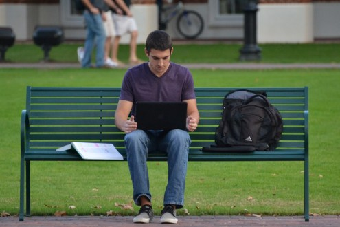 student on bench