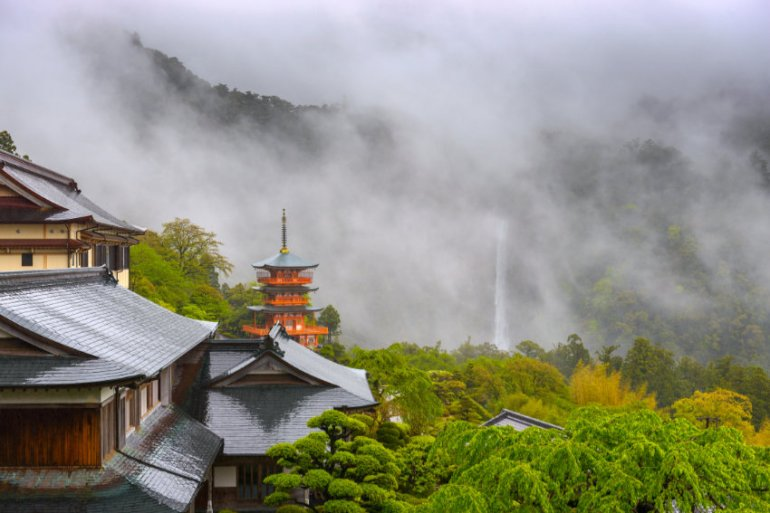Nachi temple a waterfall in the background shrouded by fog