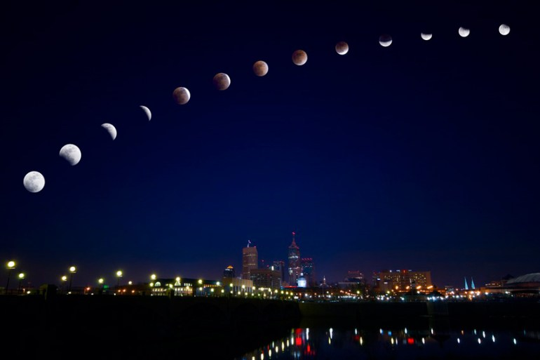moon eclipse over city