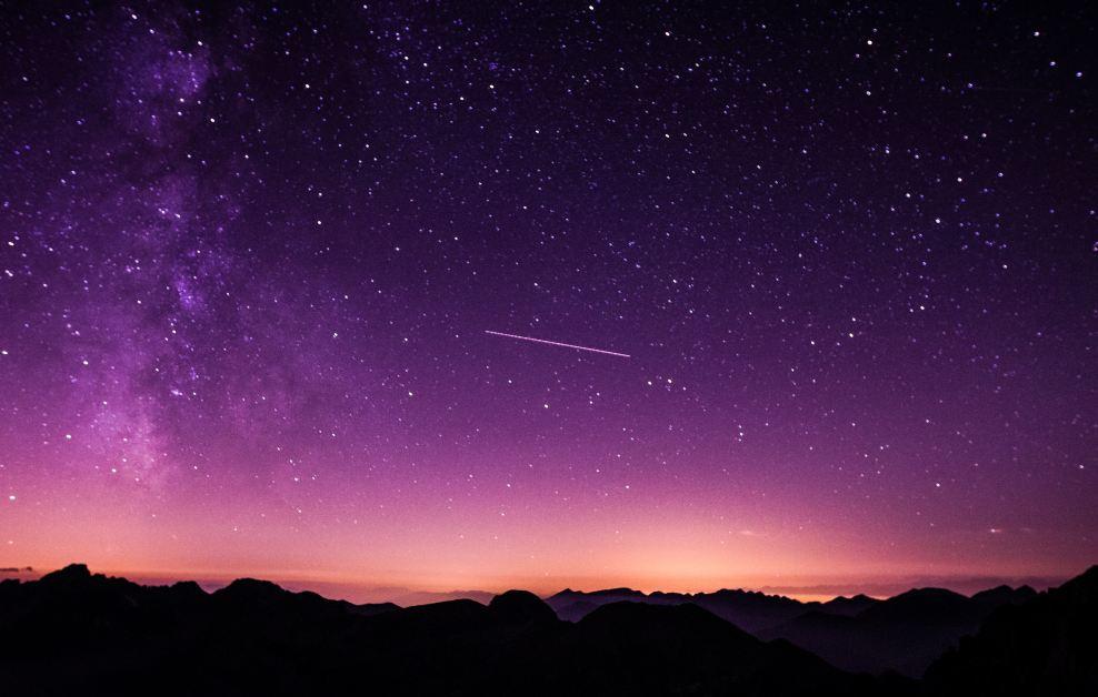 Space Name Origins: A shooting star over a mountain range