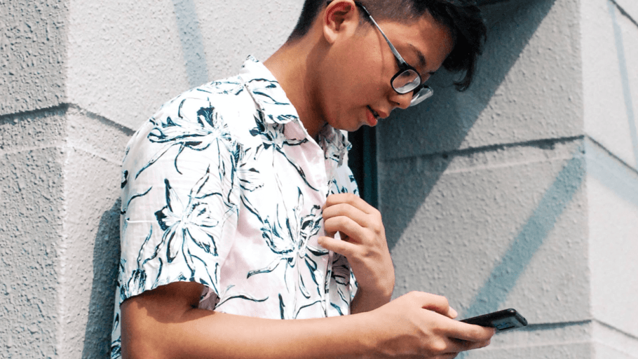 Young man using his phone outside