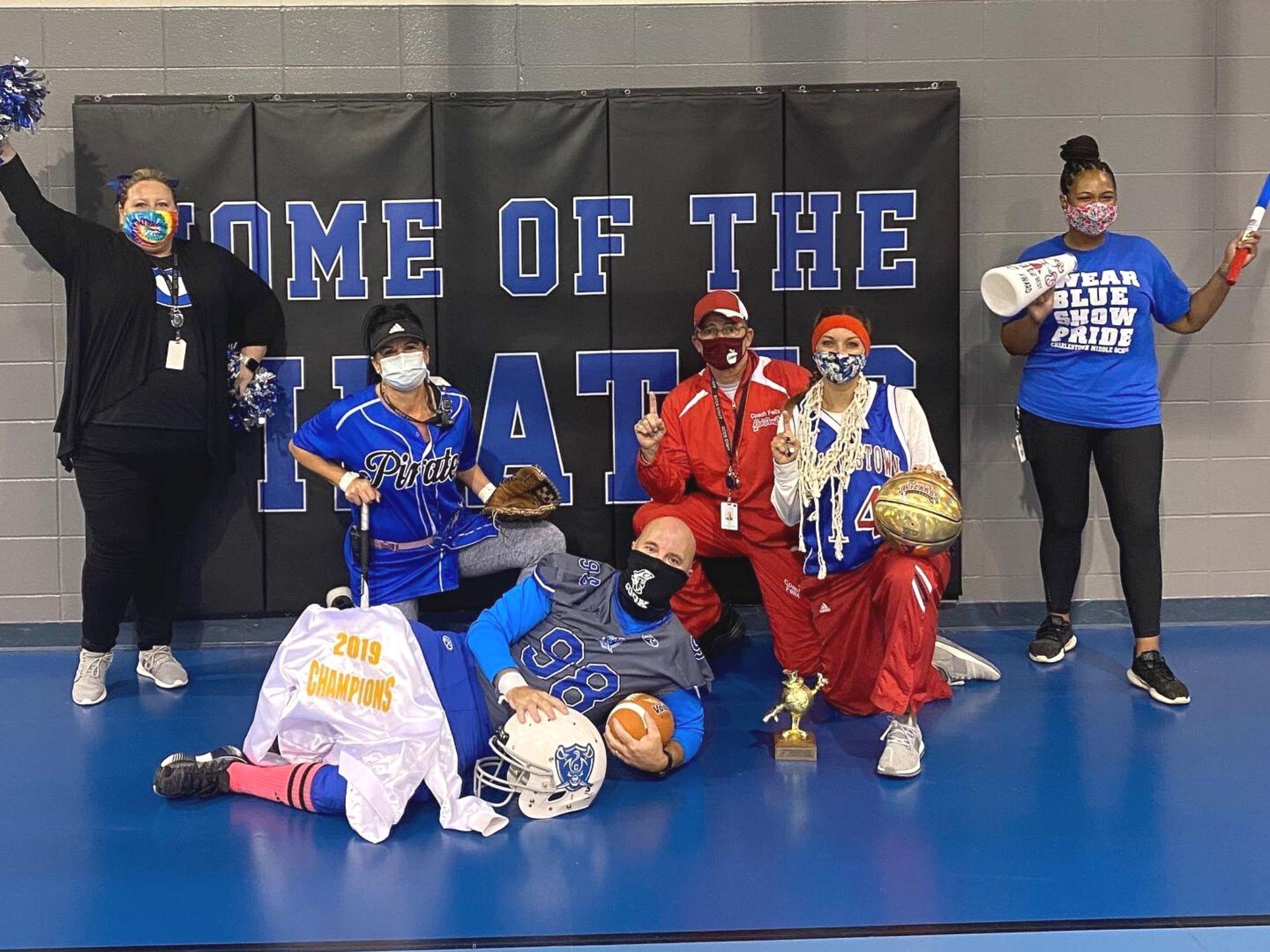 Staff members pose in team spirit wear