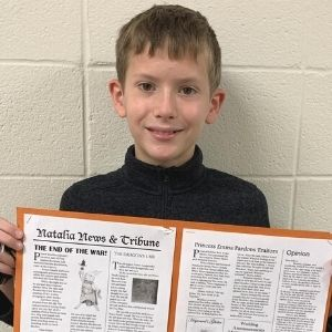 Student shows a newspaper he created