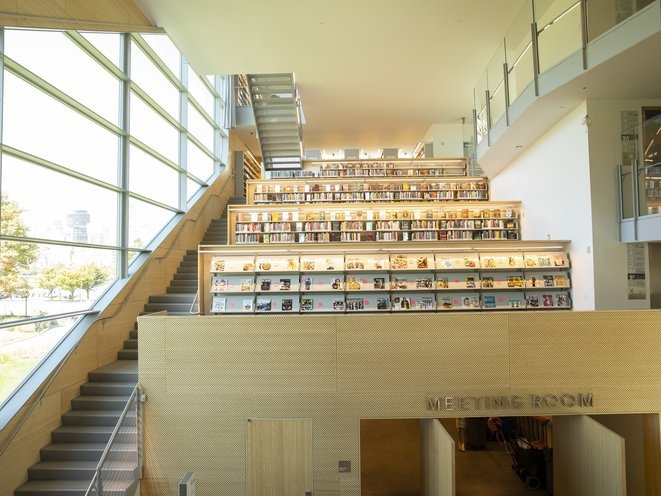 The New 41 Million Hunters Point Library Has One Major Flaw | Staircase Design For Commercial Buildings | Cylindrical Glass | Enclosed | Beautiful | Central Staircase | Sleek
