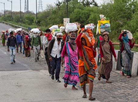 Scores of migrant workers and daily wagers walk back to their villages from Delhi.