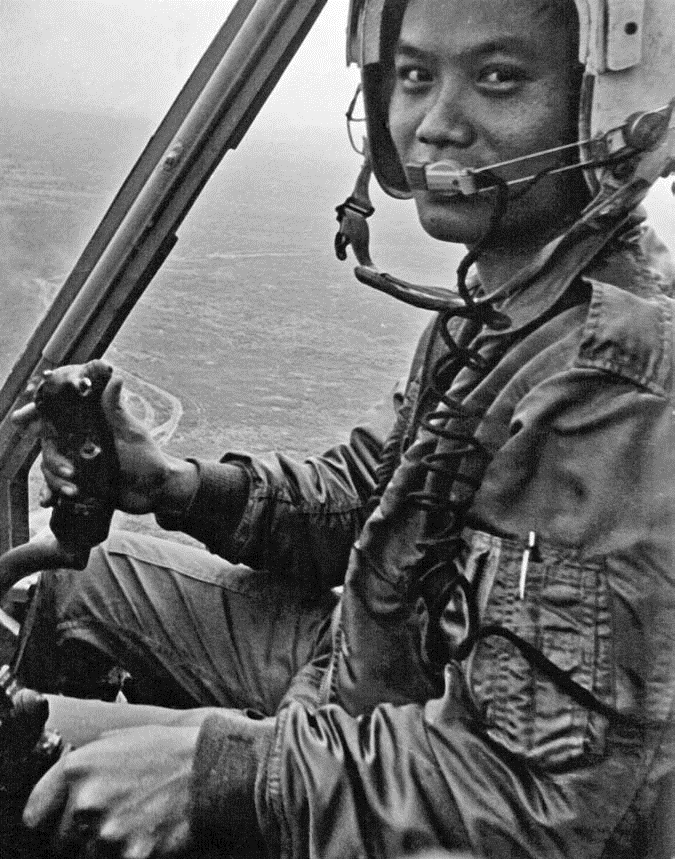 Capt. Nguyen Van Tuong at the controls of his H-34 Kingbee