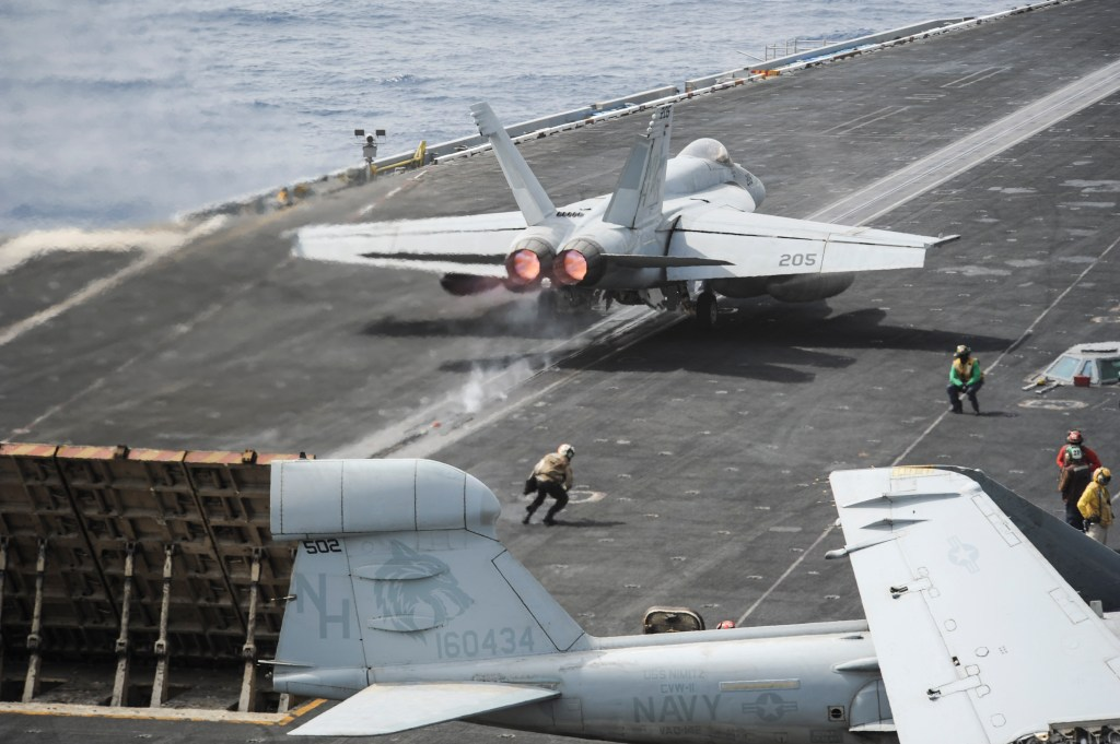 An F/A-18E Super Hornet assigned to the Argonauts of Strike Fighter Squadron (VFA) 147 launches off the flight deck of the aircraft carrier USS Nimitz (CVN 68). The Nimitz Carrier Strike Group is deployed to the U.S. 5th Fleet area of responsibility conducting maritime security operations and theater security cooperation efforts. (U.S. Navy photo by Mass Communication Specialist Seaman Apprentice Kelly M. Agee/Released)