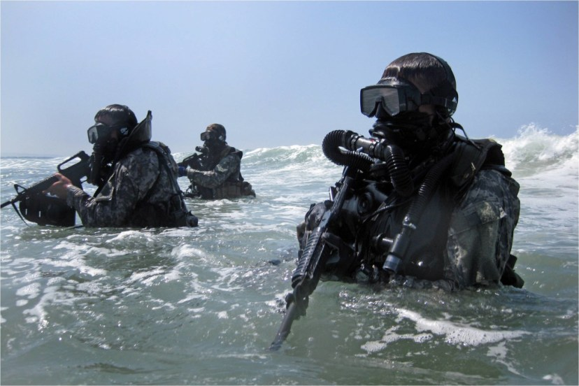 Soldiers perform a seaborne infiltration as part of training at the Special Forces Underwater Operations School in Key West, Fla. The four-week long Combat Diver Qualification Course run by the U.S. Army John F. Kennedy Special Warfare Center and School, trains qualified combat divers in a variety of waterborne operations.