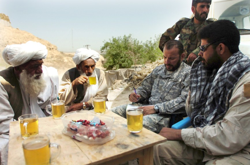A Special Forces company commander meets with village elders and members of the 1st Kandak, 209th Afghan National Army Corps April 10, 2007, to discuss military operations in the Sangin District area at an undisclosed forward operating base in Helmand Province, Afghanistan. (U.S. Army photo by Spc. Daniel Love) (Released)