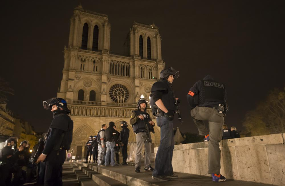 Armed police officers patrolling around Notre-Dame cathedral and the Saint-German neighborhood in Paris (Ian Langsdon/EPA)