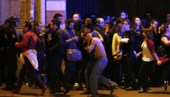 The wounded are evacuated outside the Bataclan theatre (Yoan Valat/EPA)