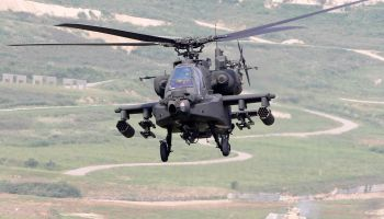 Ride inside Apache helicopter during low-level maneuvers