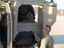 Rigging the truck up prior to Convoy Operations during Enhanced Mojave Viper (EMV).