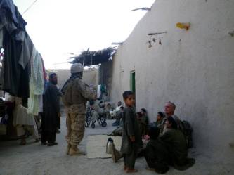 Local villagers of Malozai come to be seen by the SARC.