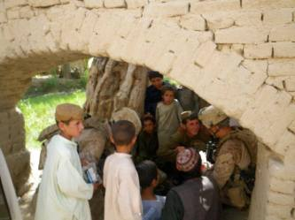 SARC passing out candy to the kids during COIN Operations in Kotazai Village, Upper Sangin Valley.