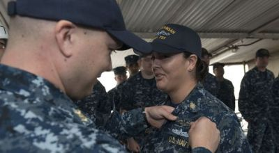 "First female enlisted sailor pins on her submariner's ""Silver Dolphins"""