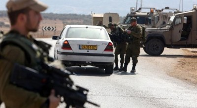 Israel says troops kill Palestinian who injured three in car attack