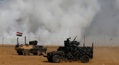 US Troops mask up against toxic fumes in Iraq