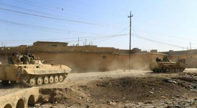 Iraqi forces grind on in east Mosul as political rift opens over Shi'ite militias