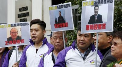 China jails nine over protests in 'democracy' village