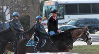 New Secretary of Interior arrives to work on horseback