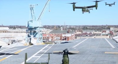 Watch: President Trump Lands on Deck of USS Ford. Brings Lots of Friends!