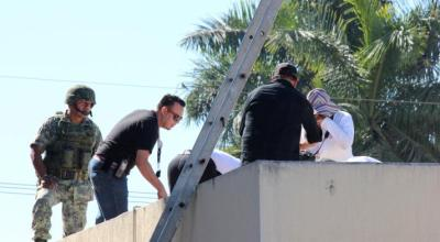 Man's body, seen tossed from plane, found on roof of Mexican hospital
