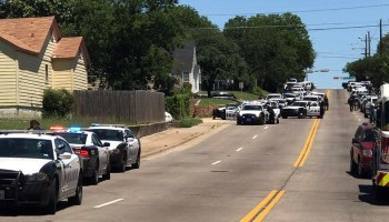 One paramedic, one civilian shot in Dallas. Police surround barricaded shooter