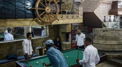 Smoke-filled pool halls are back in Mosul. After ISIS, 'we seek joy.'