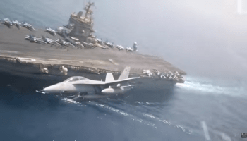 Watch: Video shot inside the cockpit of a Super Hornets as they make high-speed passes over the USS Enterprise
