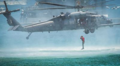 Picture of the Day: Air Force Pararescueman Enters Water from HH-60G Pave Hawk