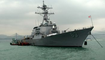 U.S. Destroyer challenges China's claims of territorial waters. China launches navy ships, fighter jets in response