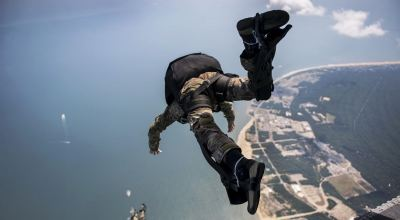 Picture of the day: US Navy Explosive Ordnance Disposal Technicians jump from a CH-47 Chinook helicopter