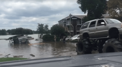 Watch: Lifted 'Redneck Army' Cadillac Escalade saves Army 5 ton truck from Texas flood waters